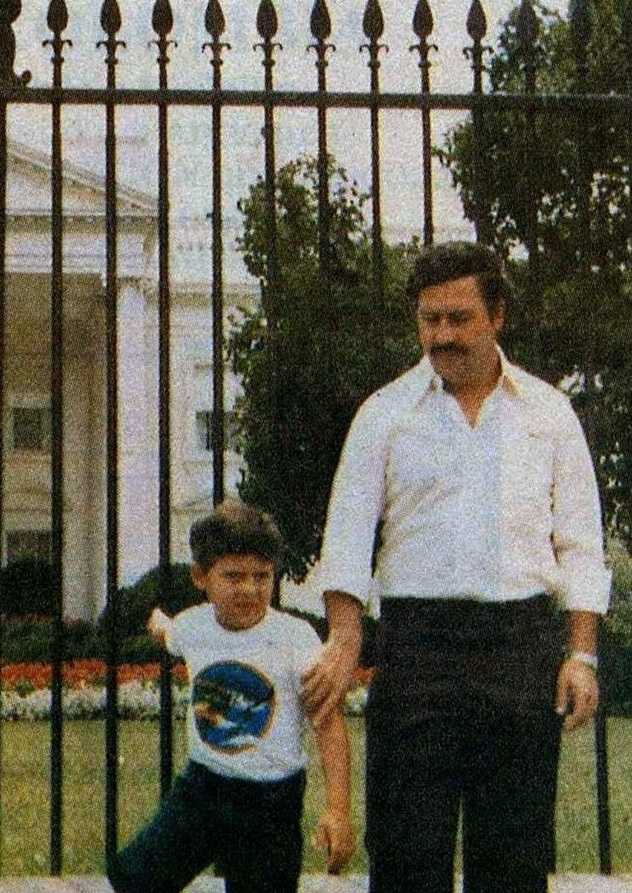 Notorious drug lord Pablo Escobar and his son in front of the White House. 1980′s