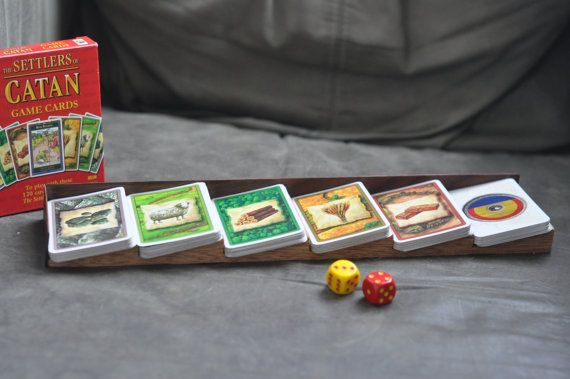 Settlers of Catan card holder. Love it!    http://pipiloproductions.bigcartel.com/product/the-settlers-of-catan-card-holder