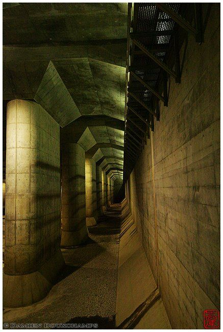 This is not a level of DooM. It's Edogawa flood prevention system's main buffer tank, north of Tokyo. The size of this underground cathedral is 177x78x28m  Other pictures of Japan, Tokyo (東京) and G-Cans (首都圏外郭放水路の龍Q館).
