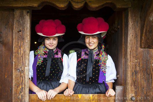Portrait of young women in tradtional Protestant folk costume, Black Forest Open Air Museum Vogtsbauernhof, Gutach, Black Forest, Baden-Wurttemberg, Germany