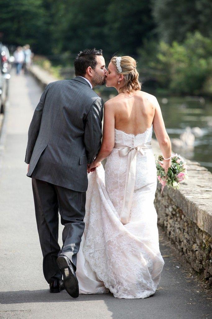 Bride and Groom walking to Arlington Row in Bibury