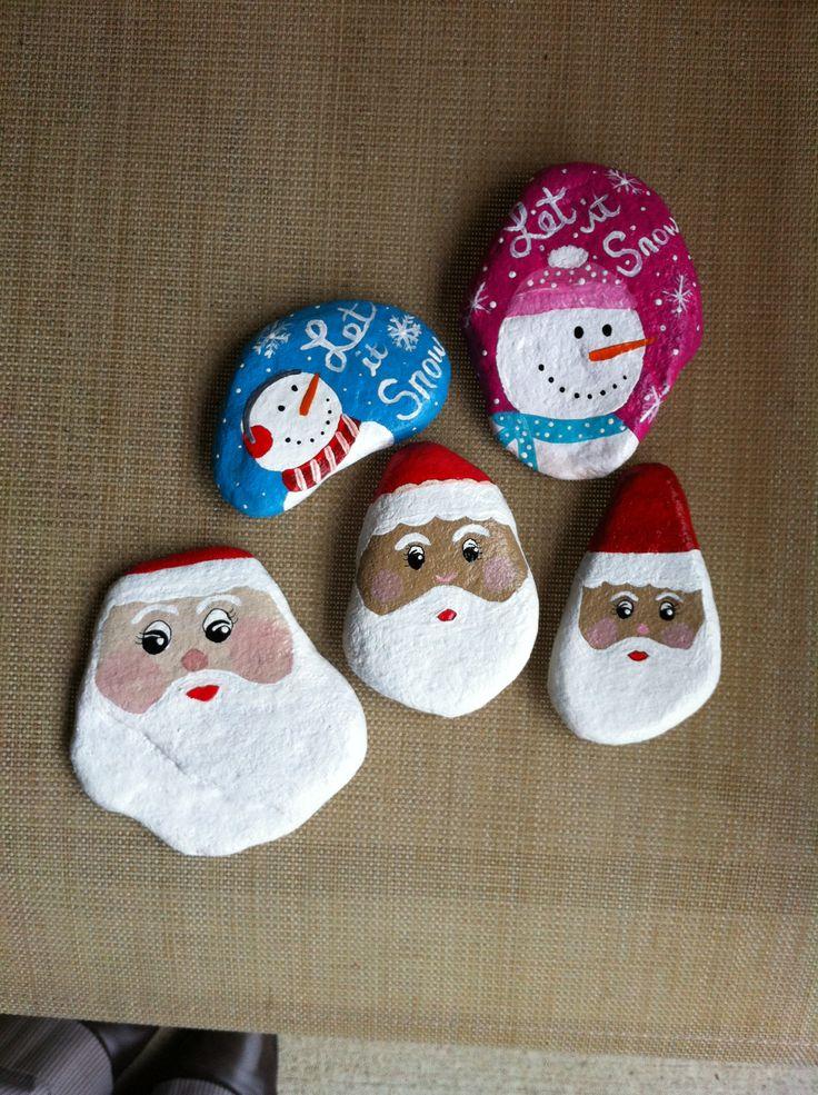 Santa's and snowmen painted rocks