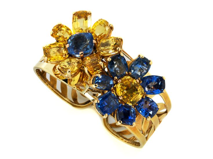 """Magnificent yellow and blue sapphire set Diameter of bracelet: ca. 16 cm.  Diameter of two detachable flowers: each ca. 3 cm.  Ring size: 52.  Length of brooch: ca. 8 cm.  Width: ca. 5.5 cm.  Total weight: ca. 126 g.  14-ct rose gold and yellow gold.  The bracelet inscribed """"Cartier""""."""