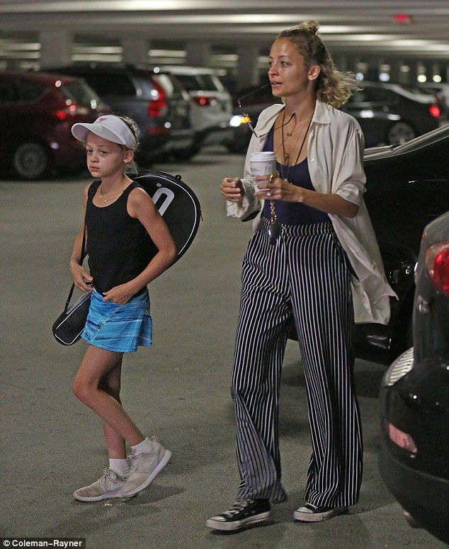 Holding court: Nicole Richie dropped daughter Harlow, nine, off at a tennis camp in the up...
