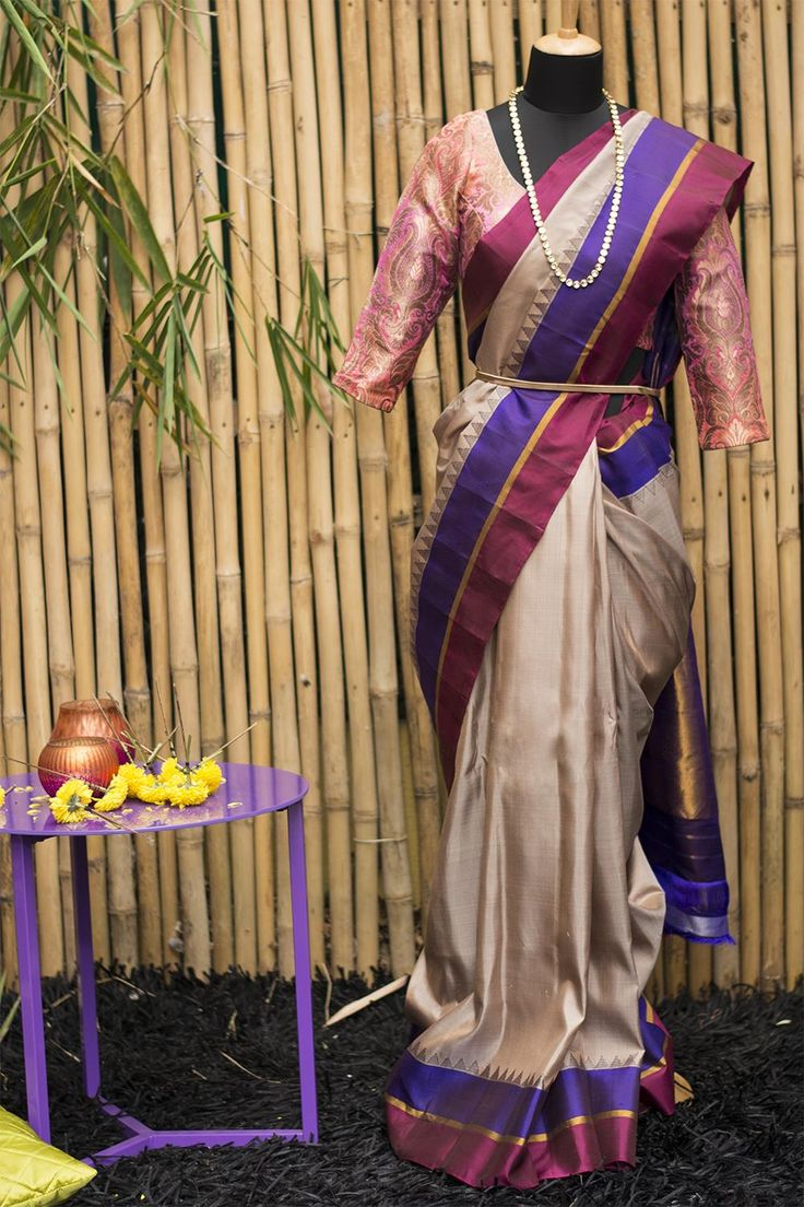 Just be gorgeous! Wrapped in yards of this light beige Gadhwal pure silk, you will be. Note the border in solid colors of purple and maroon with traditional temple motif touches in grey. Be the gracious host or the bridesmaid in attending, this saree can play multiple roles while keeping the integrity of being a pure silk drape. And do checkout the rich woven pallu. #houseofblouse #festive #saree #puresilk #blouse #indianwear #india #fashion #bollywood