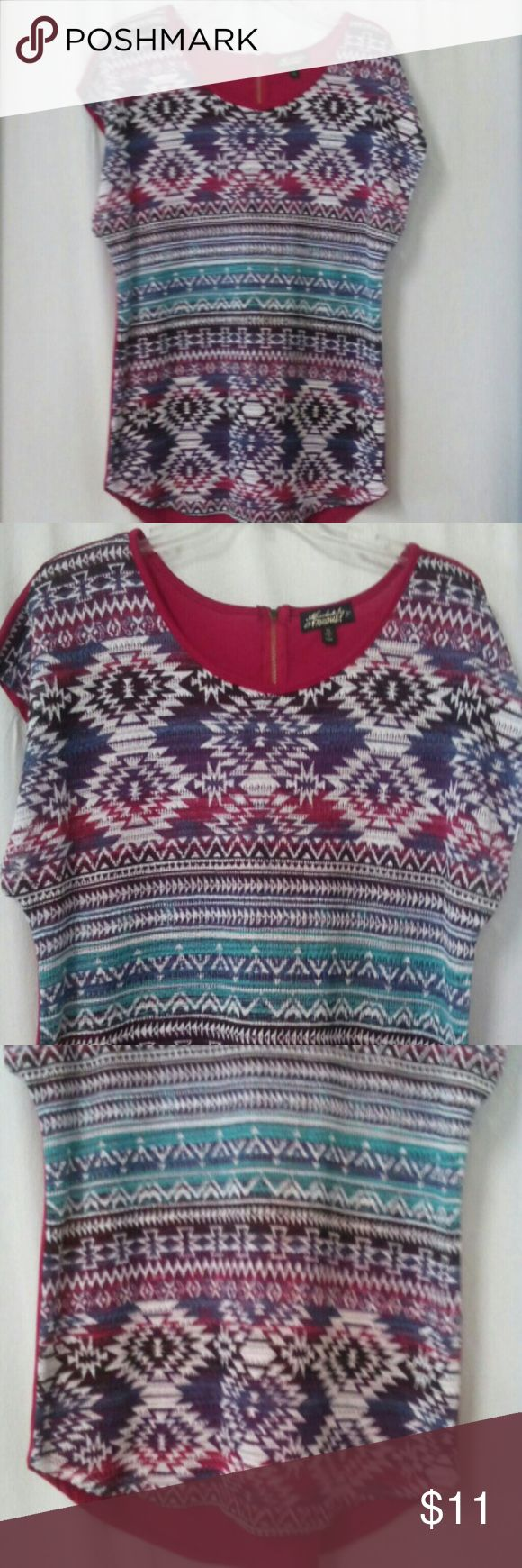 """Absolutely Famous Women's Size XL Top Barely worn, turquoise, white, burgundy, purple, black and navy Aztec pattern, burgundy back of Top,  sleeveless, zipper at the back of the neck, rayon and polyester, chest 44"""", length 27"""" in front and 29 1/2"""" in back Absolutely Famous Tops"""