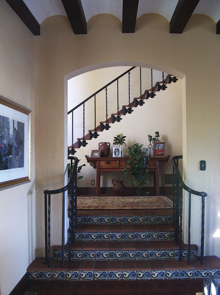 The 1915 San Diego Expo started the Spanish Revival movement. It really took hold in California in the 20s & 30s. This Point Loma home represents that influence. #staircase #stairs #tile #riser #Mexican #Spanish #Hacienda #iron #stucco #beams