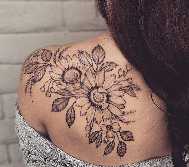 Sunflower tattoo shoulder black white #flower tattoo #tattootrends #women #tattoodesign #flowertattoo