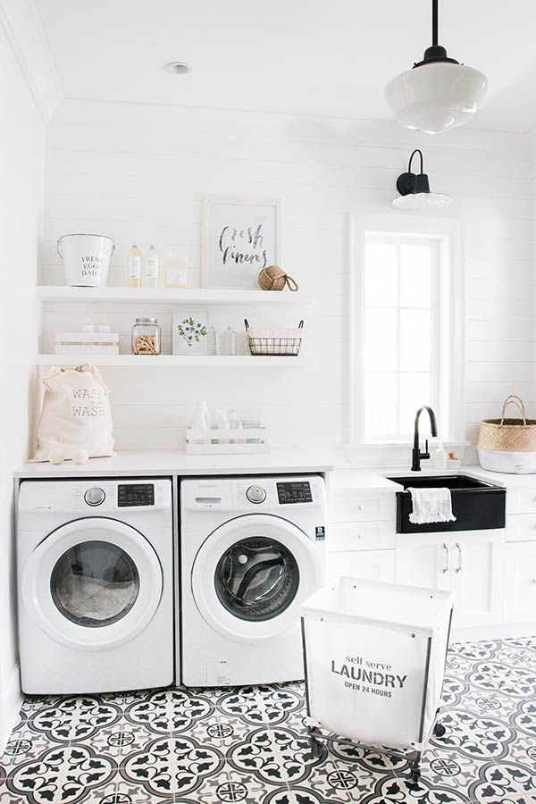 All white laundry room designed by Monika Hibbs. Laundry room open shelving. Laundry room decor ideas.