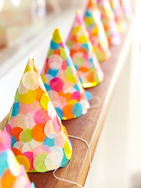 Confetti party hats for a modern or colorful party, easy to make with tissue paper dots