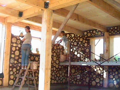 cord wood construction - visit the site to see how amazing this process is.  *I want to make our next chicken coop like this!