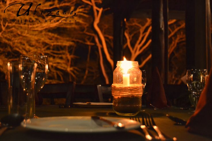 Dinner at the Tree Lodge, a view over the crocodile pond and Fever tree forest.