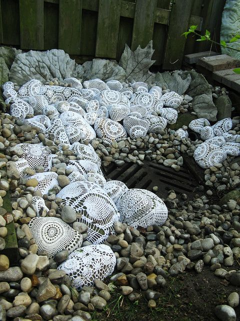 doilies on rock garden pre-moss