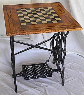 Checkerboard table with old sewing machine base