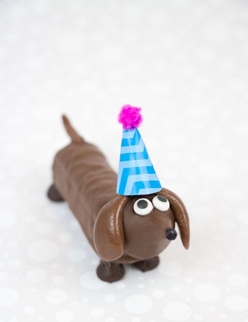 Candy Bar Party Pups - chocolate wiener dogs made from Twix, Hershey's Kisses, Tootsie Rolls and chocolate chips.