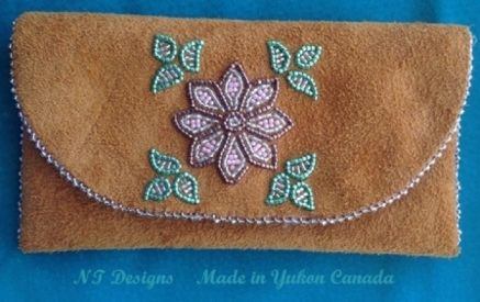Shiny beadwork on top flap tobacco pouch; moosehide, size 11 delica beads, felt lined. $80. By Florence Moses.