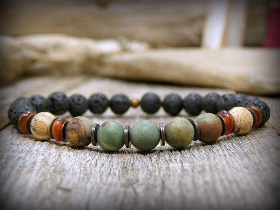 A mens bracelet in a woodsy combination of colors and stones to create this rustic bracelet for men.  Genuine semi-precious stone colors in matte green, rust and black are a great combination.  Sexy bracelet for the down to earth kinda guy!