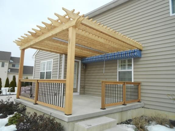 Cedar wood pergola and railings, retractable canopy installed under pergola - Harrisburg PA