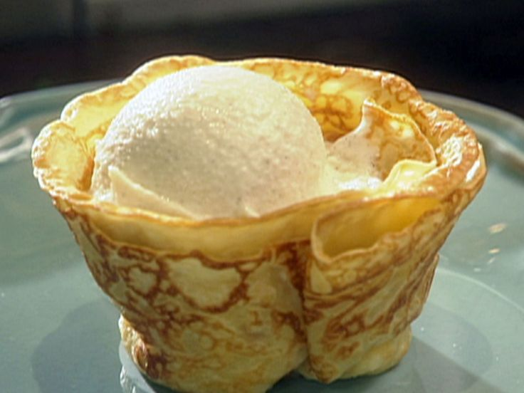 Crepes Suzette with Vanilla Ice Cream and Orange Butter Sauce recipe from Tyler Florence via Food Network