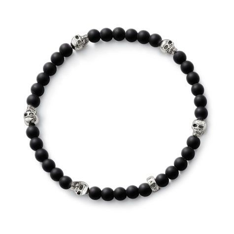 Thomas Sabo: Makes a particularly casual impact when several are worn together: bracelet made from matt obsidian beads, interrupted by miniature skulls. Size XL. $189.