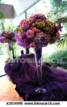 Decorative Flower Arrangements on Purple Tablecloth View Large Photo Image
