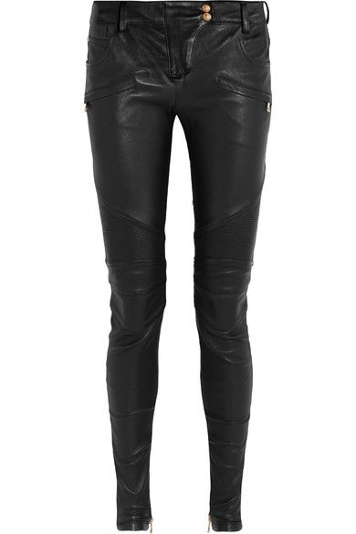 Balmain's leather skinny pants are an iconic style that will transcend seasons. This supple pair is punctuated with embossed gold buttons, zipped cuffs and ribbed knee panels that add to its moto-inspired feel. Contrast their sleek feel with a tactile knit.