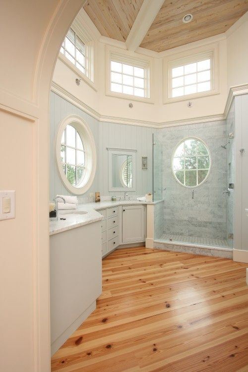 beautiful wood floor, love the windows and the shower