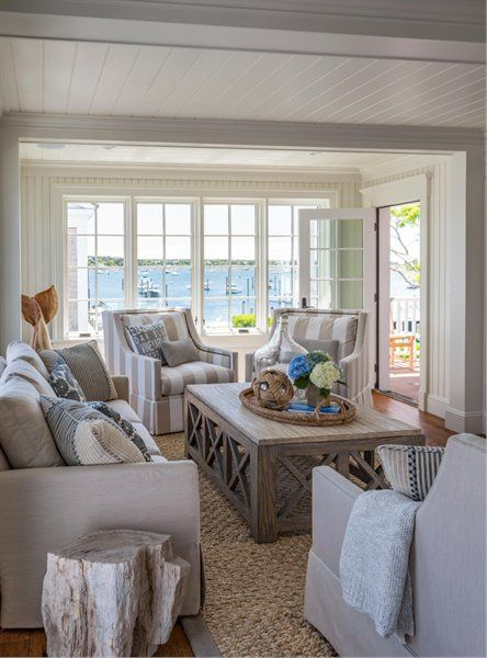 Stylish Coastal Living Room With Thick Woven Rug And Large Wooden Coffee  Table. Cozy Coastal