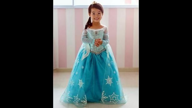 Kristin thinks that I could make this for less: Housewife Ainsley Yip bought a Disney original dress on eBay, which cost US$80, for her daughter Rianne Chew (above). -- PHOTO: COURTESY OF ...