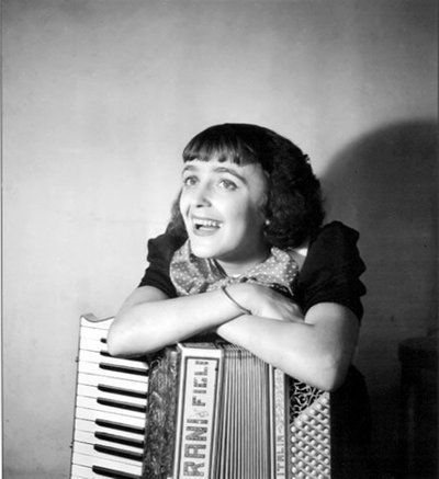 """Edith Piaf in 1936. Piaf (1915-1963) was a French singer and cultural icon who became widely regarded as France's national popular singer, as well as being one of France's greatest international stars. Her singing reflected her life, with her specialty being ballads, such as """"La vie en rose""""."""