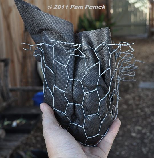 filling the cinder block with chicken wire and landscape fabric for the plants