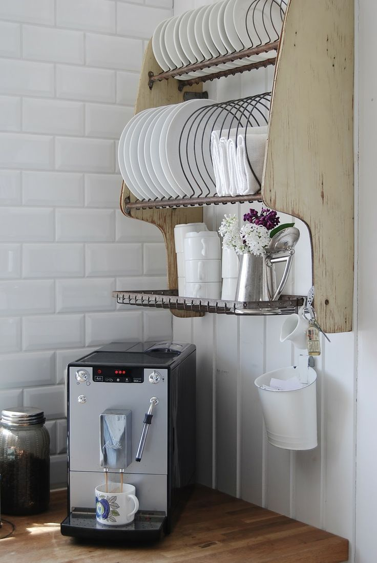 Hanging dish rack with mug hooks on bottom. We would need a more horizontal one.