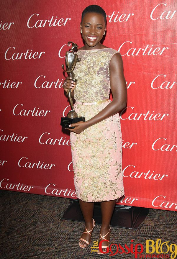 Lupita Nyong'o looked beautiful in Elie Saab as she picked up the Breakthrough Performance Award for her role in '12 Years a Slave'.