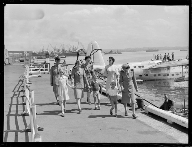 Unidentified passengers and crew disembarking from the TEAL Short Tasman class Sunderland Flying Boat ZK-AME at Mechanic's Bay, Auckland City