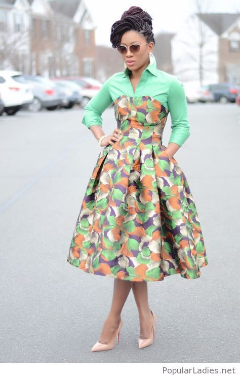 Printed dress, green shirt and nude pumps