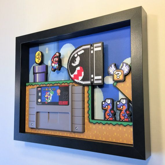 Its a Super Mario World shadowbox cartridge holder!  FREE SHIPPING TO USA AND CANADA  -The frame is 8 x 10, and is included. -Ready to hang -Best gift of all time for gamers and retrogamers -I use only UV pigment inks and acid free materials for years of fade-free enjoyment  The art is made from meticulously cut prints and foamboard, and (optionally) includes a replica cartridge. The frame is 8 x 10, and is included. (The glass has been removed for the photos, but yours will have glass)…