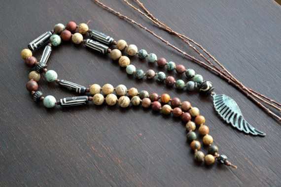 This beautiful rustic boho necklace features a patina angel wing pendant and assorted natural jasper and bone. The organic tones and colors of the jasper are gorgeous together. The bold patterned batik bone beads gives it a modern tribal vibe. Great necklace for all your boho tribal styles.  Length: 18 1/2 long - Approx 36 end to end.....  *****Your handmade item will be packaged in a hand-selected cotton batik bag that I have crafted and sewn myself. Tied with a pretty organza ribbon. Great…