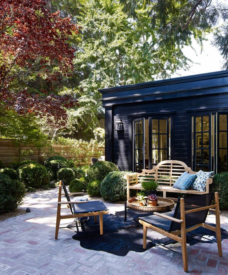Black exterior with pretty outdoor seating
