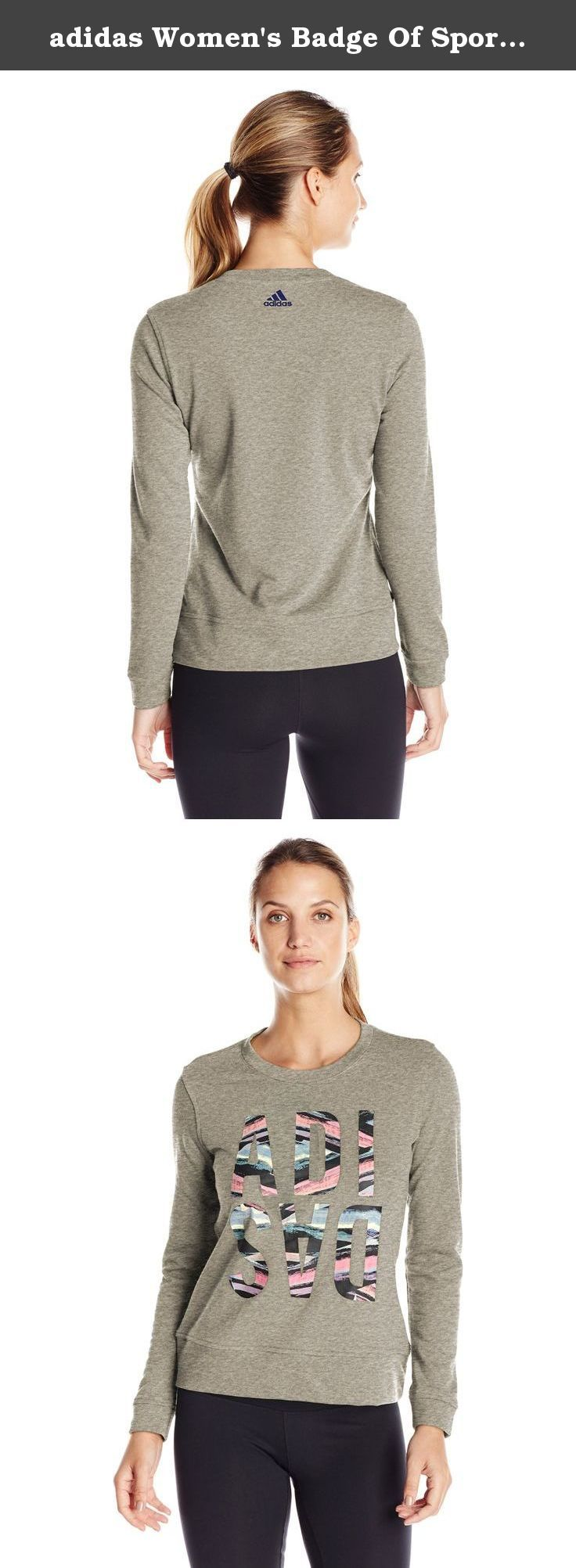 adidas Women's Badge Of Sport Graphic Long Sleeve Tee, X-Large, Medium Grey Heather/Dessert Print. This Women's sweatshirt is made of comfy French terry, with Cuffed sleeves and hem to keep the shirt in place when you move. adidas Letters filled in with a colorful print complete the athletic look.