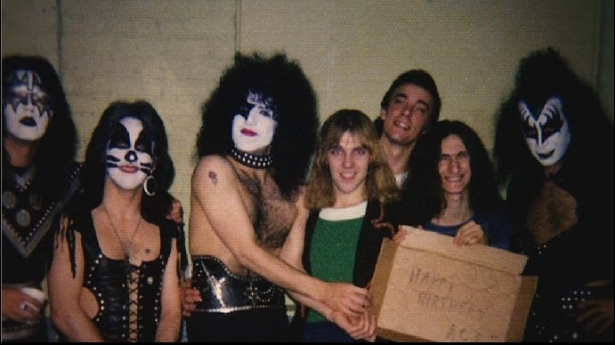 This backstage shot (captured in 1975) is all kinds of awesome: (l-r) Ace Frehley, Peter Criss, Paul Stanley, Alex Lifeson, Neil Peart, Geddy Lee and Gene Simmons.