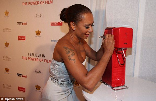 Signing the prize: Mel added her autograph to a Soda Stream machine that was being auctioned during the charity dinner