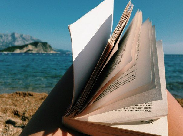 book, sea & girl