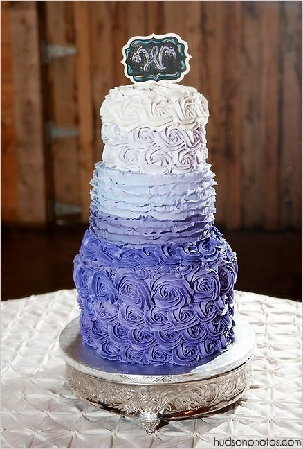 Purple hombre wedding cake for Claire and Derek with butter-cream rosettes and fondant ruffles. Each tier had 6 layers of purple hombre cake, graduating the color from dark purple to lavender. Photo courtesy of Hudson Photography.