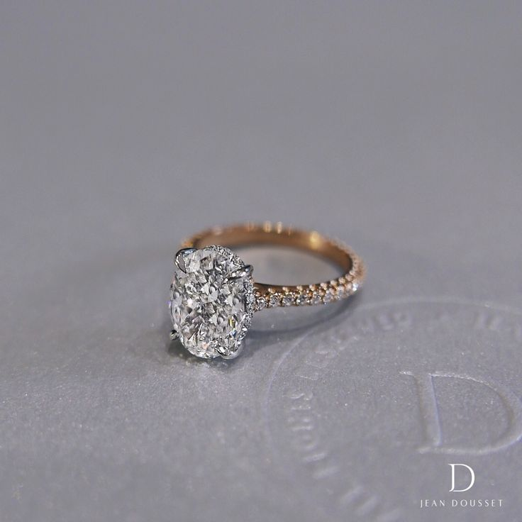 The Luna, two-tone 3.0 carat oval cut diamond engagement ring, is available in platinum or 18K white gold, yellow gold or rose gold, handcrafted by Jean Dousset.