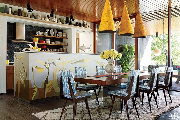 Jonathan Adler's dining room: Adler chairs covered in a Lee Jofa fabric surround a vintage Milo Baughman table from Vermillion 20th Century Furnishings; the kitchen island's mural is by John-Paul Philippé, and the range hood is by Electrolux. #table