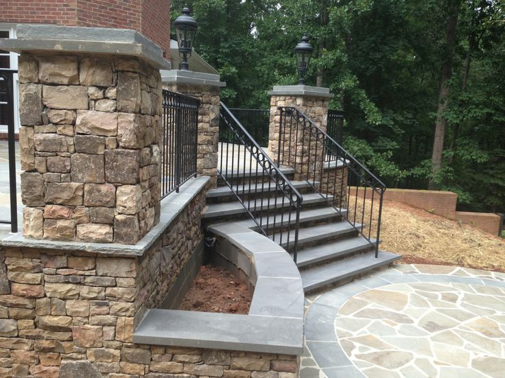 Best Bluestone Patio With Wrought Iron Rails And Stacked Stone 400 x 300
