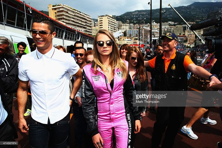 Real Madrid footballer Cristiano Ronaldo and model Cara Delevingne are seen in the pitlane before the Monaco Formula One Grand Prix at Circuit de Monaco on May 24, 2015 in Monte-Carlo, Monaco.  (Photo by Mark Thompson/Getty Images)