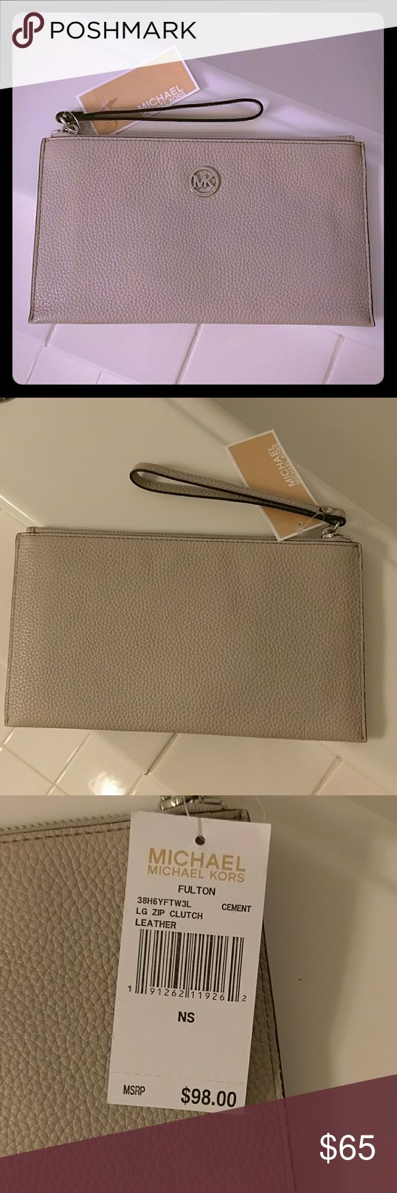 NEW Michael Kors wristlet New with tags light gray wristlet. Inside it has 6 slots for cc, one larger pocket. Approx. 10X6. No trades. Michael Kors Collection Bags Clutches & Wristlets