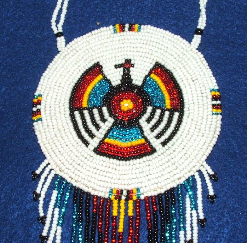 A large well made beaded rosette necklace. Thunderbird in bold colors. Fringed beadwork at bottom and beaded neck loop too! $45 w/ free shipping in USA #thunderbird #regalia #beadwork #necklace