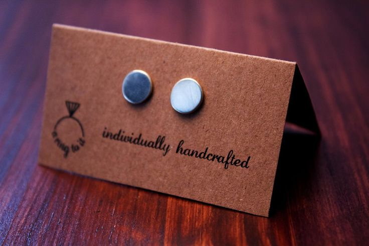 silver circle studs by a ring to it for sale on http://hellopretty.co.za